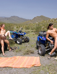 Horny babes meet two guys in the desert and fuck them hard