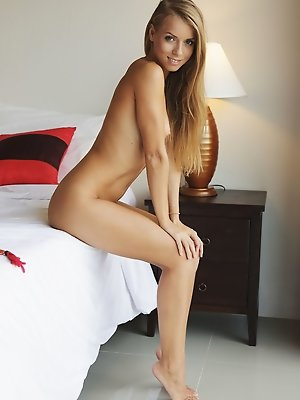 Stella Lane sensually poses on the bed baring her delectable body.